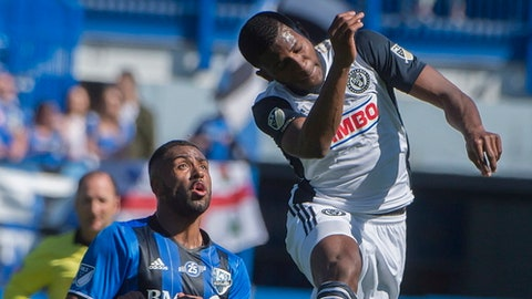 Philadelphia Union's Mark McKenzie, right, heads the ball during first-half MLS soccer game action against the Montreal Impact in Montreal, Saturday, May 12, 2018. (Peter McCabe/The Canadian Press via AP)