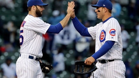 Chicago Cubs closer Brandon Morrow, left, celebrates with first baseman Anthony Rizzo after the Cubs defeated the Chicago White Sox 8-4 in a baseball game Saturday, May 12, 2018, in Chicago. (AP Photo/Nam Y. Huh)