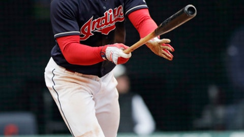 Cleveland Indians' Francisco Lindor watches his solo home run off Kansas City Royals Kevin McCarthy during the seventh inning of a baseball game Saturday, May 12, 2018, in Cleveland. The Indians won 6-2. (AP Photo/Tony Dejak)