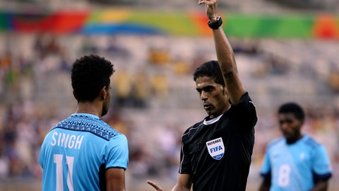 FILE - In this Wednesday, Aug. 10, 2016 file photo, Fiji's Alvin Singh is yellow carded by referee Fahad Al Mirdasi of Saudi Arabia during a group C match of the men's Olympic football tournament between Germany and Fiji at the Mineirao Stadium in Belo Horizonte, Brazil. A World Cup-bound referee, who is one of Asian footballs most experienced officials, has been placed under investigation in Saudi Arabia. The Saudi Football Federation removed Fahad Al Mirdasi from overseeing the Kings Cup final on Saturday, May 12, 2018 after referred him to administrative investigators. (AP Photo/Eugenio Savio, file)