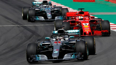 Mercedes driver Lewis Hamilton of Britain, front, leads and followed by Ferrari driver Sebastian Vettel of Germany, right, and Mercedes driver Valtteri Bottas of Finland, during the Spanish Formula One Grand Prix at the Barcelona Catalunya racetrack in Montmelo, Spain, Sunday, May 13, 2018. (AP Photo/Manu Fernandez)