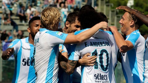 Lazio's Senad Lulic, center, face to the camera,  is celebrated by his side's first goal during the  Serie A soccer match between Crotone and Lazio at Ezio Scida stadium in Crotone, Italy, Sunday May 13,  2018. (Albano Angiletta/ANSA via AP)