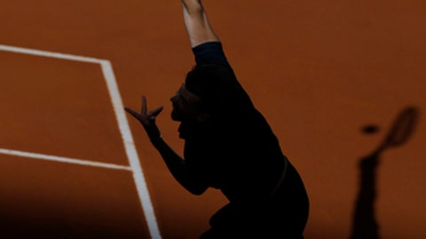 Dominic Thiem of Austria serves to Alexander Zverev of Germany during the men's final of the Madrid Open Tennis tournament in Madrid, Spain, Sunday May 13, 2018. (AP Photo/Francisco Seco)