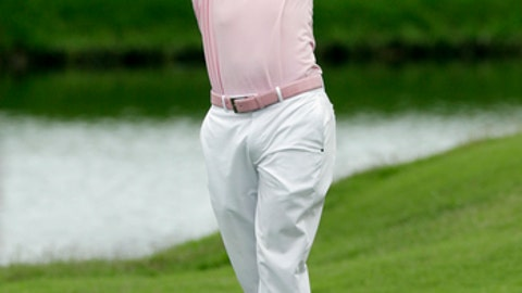 Justin Thomas hits from the ninth fairway, during the final round of The Players Championship golf tournament Sunday, May 13, 2018, in Ponte Vedra Beach, Fla. (AP Photo/John Raoux)