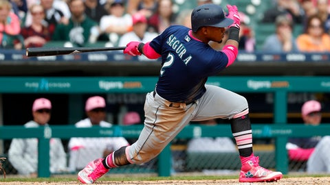 Seattle Mariners' Jean Segura (2) hits a two-run single in the eighth inning of a baseball game against the Detroit Tigers in Detroit, Sunday, May 13, 2018. (AP Photo/Paul Sancya)