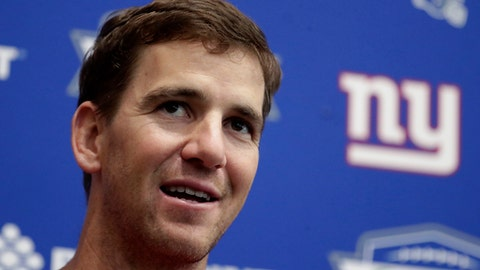 "FILE - In an April 25, 2018 file photo, New York Giants quarterback Eli Manning speaks to reporters during NFL football training camp, in East Rutherford, N.J. Jury selection is scheduled to begin on Monday, May 14, 2018, in a New Jersey memorabilia dealers lawsuit that accuses New York Giants quarterback Eli Manning of conspiring with the team's equipment staff to sell bogus ""game-used"" helmets to unsuspecting collectors as part of a long-running scam.(AP Photo/Julio Cortez, File)"