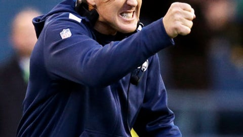 file-This Nov. 3, 2013 file photo shows Seattle Seahawks head coach Pete Carroll reacting to the Tampa Bay Buccaneers quarterback being sacked late in overtime in an NFL football game  in Seattle. Chuck Knox never did it and neither did Mike Holmgren. The Seattle Seahawks have never had consecutive 10-win regular seasons until now under Pete Carroll. At 10-1, they have the best record in the NFL heading into their bye week. (AP Photo/Elaine Thompson, File)