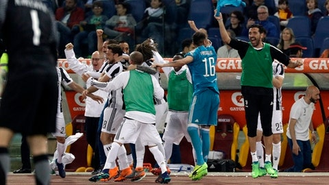 Juventus goalkeeper Gianluigi Buffon, right, celebrates with teammates at the end of the Serie A soccer match between Roma and Juventus, at the Rome Olympic stadium, Sunday, May 13, 2018. The match ended in a scoreless draw and Juventus won record-extending seventh straight Serie A title. (AP Photo/Gregorio Borgia)