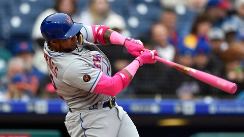 New York Mets' Yoenis Cespedes hits a solo home run off Philadelphia Phillies' Aaron Nola during the sixth inning of a baseball game, Sunday, May 13, 2018, in Philadelphia. (AP Photo/Derik Hamilton)