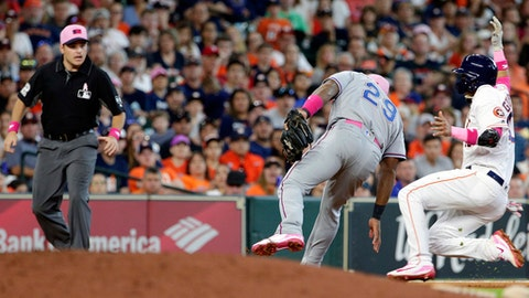 Third base umpire Jansen Visconti, left, watches as Texas Rangers third baseman Adrian Beltre (29) reaches with an empty hand to tag Houston Astros' Yuli Gurriel,right, during the seventh inning of a baseball game Sunday, May 13, 2018, in Houston. (AP Photo/Michael Wyke)
