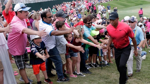 Fans greet Tiger Woods as he exits the 18 hole, during the final round of The Players Championship golf tournament Sunday, May 13, 2018, in Ponte Vedra Beach, Fla. (AP Photo/Lynne Sladky)