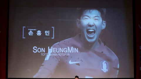 South Korea's national soccer team head coach Shin Tae-yong, center bottom, announces a name of Son Heung-min as a member of squad for the 2018 Russia World Cup during a press conference in Seoul, South Korea, Monday, May 14, 2018. (AP Photo/Lee Jin-man)