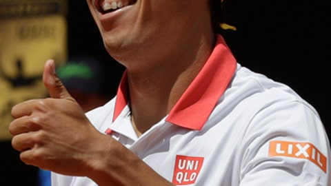 Japan's Kei Nishikori celebrates after winning a point during his match against Spain's Feliciano Lopez at the Italian Open tennis tournament, in Rome, Monday, May, 14, 2018. (AP Photo/Alessandra Tarantino)