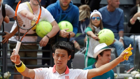 Japan's Kei Nishikori celebrates after winning his match against Spain's Feliciano Lopez at the Italian Open tennis tournament, in Rome, Monday, May, 14, 2018. Nishikori won 7-6 (7-5), 6-4. (AP Photo/Alessandra Tarantino)