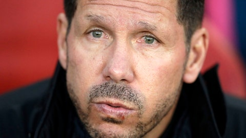 FILE - In this Thursday, April 26, 2018 file photo, Altetico's head coach Diego Simeone sits on the bench before the Europa League semifinal first leg soccer match between Arsenal FC and Atletico Madrid at Emirates Stadium in London. Marseille will play Atletico Madrid in the Europa League final on Wednesday May 16, 2018. Marseille now enjoys significant financial backing and the time is right to stop harping on about past glory and deliver another trophy. Atletico is bidding to win the Europa League for the third time this decade. (AP Photo/Matt Dunham, File)