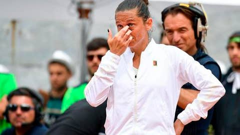 "Italy's Roberta Vinci is overwhelmed with emotion as she addresses the audience at the Italian Open tennis tournament in Rome, Monday, May 14, 2018. Former U.S. Open finalist Roberta Vinci bid her fans an emotional farewell following the final match of her career at the Italian Open on Monday. Having already announced that this would be her final tournament, the 35-year-old Vinci was beat 2-6, 6-0, 6-3 by Serbian qualifier Aleksandra Krunic. Vinci says in a post-match ceremony, ""I'm crying now but I'm happy I'm happy for what I've accomplished."" (Ettore Ferrari/ANSA via AP)"