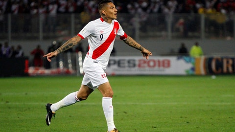 FILE - In this Tuesday, Oct. 10, 2017 filer, Peru's Paolo Guerrero celebrates after scoring against Colombia during a 2018 World Cup qualifying soccer match in Lima, Peru. Peru captain Paolo Guerrero has been banned from playing at the World Cup because of a positive doping test, it was announced on Monday, May 14, 2018. The Court of Arbitration for Sport says it has upheld an appeal by the World Anti-Doping Agency to extend Guerrero's six-month FIFA ban. (AP Photo/Rodrigo Abd, File)