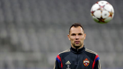 FILE - In this Tuesday Dec. 9, 2014 file photo, CSKA's Sergei Ignashevich watches the ball during a training session prior to their Champions League soccer match against FC Bayern Munich, in Munich, southern Germany. Russia has cut from its World Cup squad a player who faced a doping investigation. The Russian Football Union says defender Ruslan Kambolov picked up a calf muscle injury during a game on Sunday, May 13, 2018. He has been replaced by the 38-year-old veteran Sergei Ignashevich, who is coming out of international retirement. (AP Photo/Matthias Schrader, file)