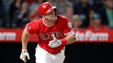 Los Angeles Angels' Mike Trout reacts after hitting a fly ball during the fourth inning of a baseball game against the Houston Astros, Monday, May 14, 2018, in Anaheim, Calif. (AP Photo/Jae C. Hong)
