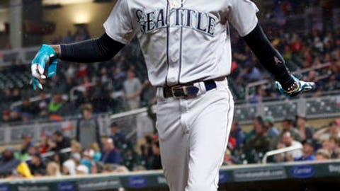 Seattle Mariners' Dee Gordon celebrates as he scores on a sacrifice bunt by Jean Segura and a throwing error in the eighth inning of a makeup baseball game, Monday, May 14, 2018, in Minneapolis. The Mariners won 1-0. (AP Photo/Jim Mone)