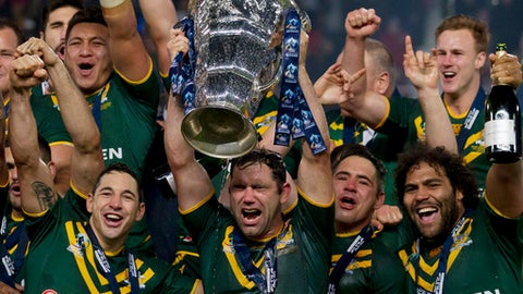 FILE - In this Nov. 30, 2013, file photo, Australia's captain Cameron Smith, bottom center, celebrates with teammates after their 34-2 win over New Zealand in their World Cup Final International Rugby League match at Old Trafford Stadium in Manchester, England. Cameron Smith announced Tuesday, May 15, 2018, that he has retired from representative rugby league, finishing a career that included 11 wins in the last 12 State of Origin series for Queensland and leading Australia to two World Cup titles. (AP Photo/Jon Super, File)