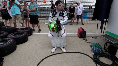 Zachery Claman DeMelo, of Canada, removes his helmet after driving during practice for the IndyCar Indianapolis 500 auto race at Indianapolis Motor Speedway in Indianapolis, Tuesday, May 15, 2018. (AP Photo/Michael Conroy)