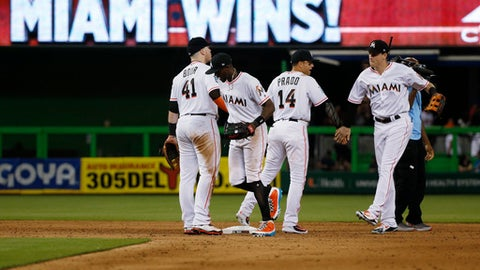Miami Marlins celebrate after defeating the Los Angeles Dodgers 4-2 during a baseball game Tuesday, May 15, 2018, in Miami. From left are Justin Bour, Cameron Maybin, Martin Prado and Brian Anderson. (AP Photo/Wilfredo Lee)