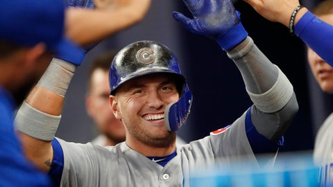 Chicago Cubs' Albert Almora Jr. (5) celebrates in the dugout after scoring the game-tying run on an Addison Russell double in the ninth inning of a baseball game against the Atlanta Braves on Tuesday, May 15, 2018, in Atlanta. Chicago won 3-2. (AP Photo/John Bazemore)