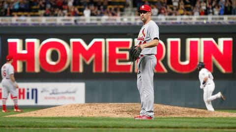 St. Louis Cardinals pitcher Luke Gregerson waits on the mound as Minnesota Twins' Bobby Wilson, right, rounds the bases on a two-run home run during the seventh inning of a baseball game Tuesday, May 15, 2018, in Minneapolis. The Twins won 4-1. (AP Photo/Jim Mone)