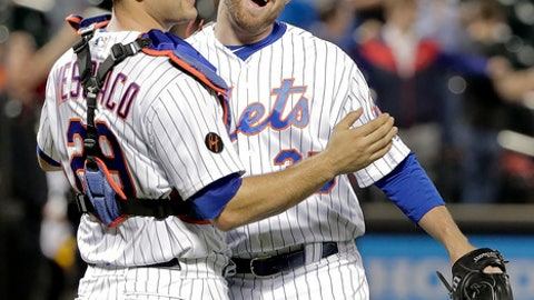 New York Mets catcher Devin Mesoraco (29) celebrates with pitcher Jacob Rhame after the Mets defeated the Toronto Blue Jays 12-2 in a baseball game Tuesday, May 15, 2018, in New York. (AP Photo/Julie Jacobson)