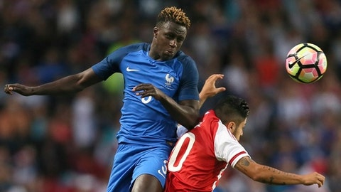 FILE - In this Friday, June 2, 2017 file photo, Benjamin Mendy of France, left, jumps for a header with Sergio Diaz of Paraguay during their friendly soccer match, in Rennes, western France. At the World Cup four years ago, Colombia forward James Rodriguez became one of the stars of the tournament and shot to international fame with his trickery on the ball and eye for a spectacular goal. Here's a look at young players hoping to make a similar impact at this year's World Cup in Russia. Among them is France left back Benjamin Mendy, Spain midfielder Marco Asensio, Belgium winger Leroy Sane, and Brazil striker Gabriel Jesus. (AP Photo/David Vincent, File)