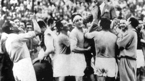 FILE - In this June 10, 1934 file photo, Italian soccer coach Vittorio Pozzo is held aloft after his team defeated Czechoslovakia 2-1 to win the World Cup final at the Fascist National Party Stadium in Rome. Italy would go on to defend the World Cup four years later in 1938 amid the drumbeat of war, with the team criticized for wearing black shirts in one of its matches.  The 21st World Cup begins on Thursday, June 14, 2018, when host Russia takes on Saudi Arabia. (AP Photo/File)