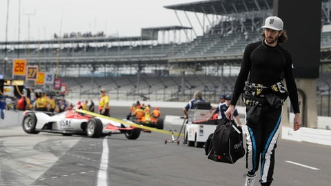 JR Hildenbrand walks down pit road before a practice session for the IndyCar Indianapolis 500 auto race at Indianapolis Motor Speedway in Indianapolis, Wednesday, May 16, 2018. (AP Photo/Darron Cummings)