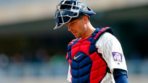 FILE - In this April 11, 2018, file photo, Minnesota Twins catcher Jason Castro waits during a break in a baseball game against the Houston Astros in Minneapolis. Castro will miss the rest of the season following surgery to remove the meniscus in his right knee, the team announced Wednesday, May 16, 2018.  (AP Photo/Jim Mone, File)
