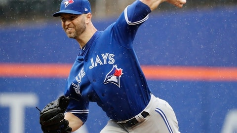 Toronto Blue Jays' J.A. Happ delivers a pitch during the first inning of a baseball game against the New York Mets, Wednesday, May 16, 2018, in New York. (AP Photo/Frank Franklin II)