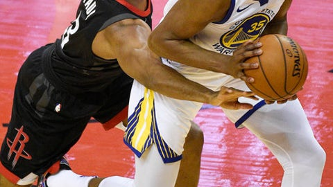Houston Rockets guard Chris Paul, left, reaches for the ball held by Golden State Warriors forward Kevin Durant during the first half of Game 2 of the NBA basketball playoffs Western Conference finals Wednesday, May 16, 2018, in Houston. (AP Photo/Eric Christian Smith)
