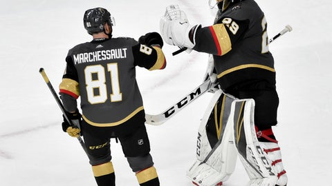 Vegas Golden Knights center Jonathan Marchessault, left, celebrates with goaltender Marc-Andre Fleury after the teams 4-2 win against the Winnipeg Jets during Game 3 of the NHL hockey playoffs Western Conference finals Wednesday, May 16, 2018, in Las Vegas. (AP Photo/David Becker)