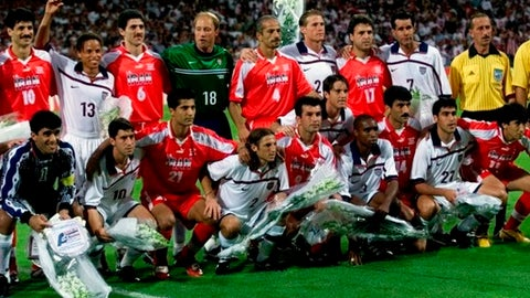 FILE - In this Sunday, June 21, 1998 file photo, US and Iranian players pose for a group photo before the start of their World Cup soccer match, at Gerland Stadium, in Lyon, France. The World Cup often throws up geopolitical clashes. In 1998, the big one was between the US and Iran but the two sides sought to keep a lid on their countries' differences. The 21st World Cup begins on Thursday, June 14, 2018, when host Russia takes on Saudi Arabia. (AP Photo/Michel Euler, File)