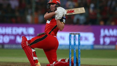 Royal Challengers Bangalore's AB de Villiers watches his shot during the VIVO IPL Twenty20 cricket match against Sunrisers Hyderabad in Bangalore, India, Thursday, May 17, 2018. (AP Photo/Aijaz Rahi)