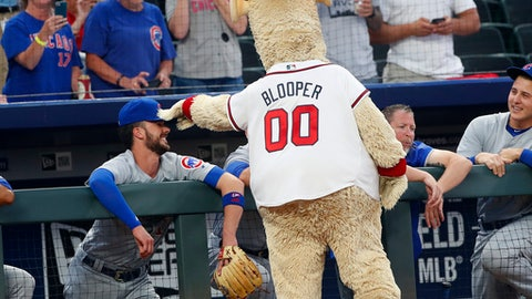 Atlanta Braves mascot Blooper jokes with Chicago Cubs third baseman Kris Bryant before a baseball game Thursday, May 17, 2018, in Atlanta. (AP Photo/John Bazemore)