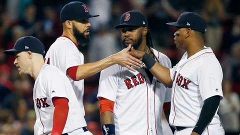 Boston Red Sox's David Price, second from left, celebrates with teammates, from left, Brock Holt, Hanley Ramirez and Rafael Devers after the Red Sox defeated the Baltimore Orioles 6-2 in a baseball game in Boston, Thursday, May 17, 2018. (AP Photo/Michael Dwyer)