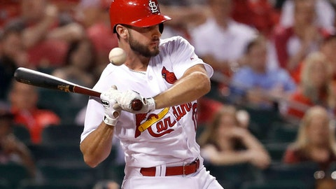 The ball bounces off St. Louis Cardinals' Paul DeJong after he was hit by a pitch during the eighth inning of a baseball game against the Philadelphia Phillies on Thursday, May 17, 2018, in St. Louis. (AP Photo/Jeff Roberson)