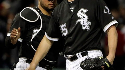 Chicago White Sox catcher Welington Castillo, left, celebrates with relief pitcher Nate Jones after the White Sox defeated the Texas Rangers 4-2 in a baseball game Thursday, May 17, 2018, in Chicago. (AP Photo/Nam Y. Huh)