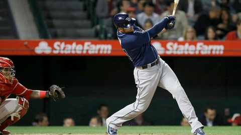 Tampa Bay Rays' C.J. Cron, right, hits a solo home run in front of Los Angeles Angels catcher Martin Maldonado during the sixth inning of a baseball game in Anaheim, Calif., Thursday, May 17, 2018. (AP Photo/Alex Gallardo)