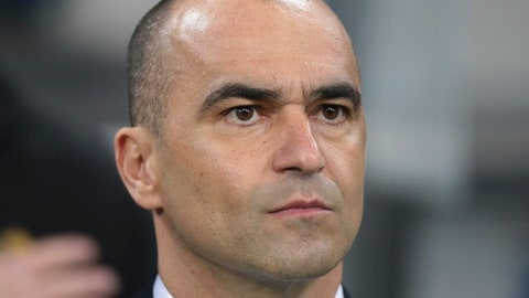 """FILE - In this March 28, 2017 file photo, Belgium coach Roberto Martinez watches the international friendly soccer match between Russia and Belgium at Fisht stadium in Sochi, Russia.  Belgium has extended the contract of coach Martinez for two years ahead of the World Cup, rewarding the Spaniard for a steady course and encouraging results. The Belgian federation said in a statement Friday, May 18, 2018,  that it """"has been delighted with this positive, professional and sincere collaboration with Roberto Martinez"""" and lauded """"Belgium's impeccable performance during the World Cup qualification."""" (AP Photo/Denis Tyrin, File)"""