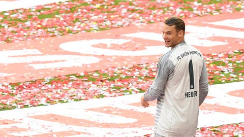 FILE - In this Saturday, May 12, 2018 file photo, Bayern goalkeeper Manuel Neuer celebrates with his team the 28th Bundesliga title in Munich. Germany goalkeeper Manuel Neuer has been included in Bayern Munichs squad for Saturdays German Cup final, boosting hopes that he will be fit enough for the World Cup. (Andreas Gebert/dpa via AP)