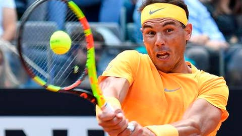 Spain's Rafael Nadal returns the ball to Italy's Fabio Fognini during a quarter final match at the Italian Open tennis tournament in Rome, Friday, May 18, 2018. (Ettore Ferrari/ANSA via AP)