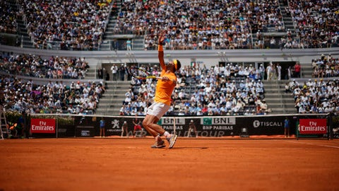Spain's Rafael Nadal serves the ball to Italy's Fabio Fognini during a quarter final match at the Italian Open tennis tournament in Rome, Friday, May 18, 2018. Nadal won 4-6, 6-1, 6-2. (AP Photo/Andrew Medichini)