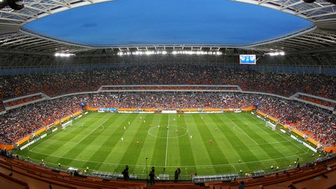In this photo taken on Wednesday, May 16, 2018, spectators watch a Russian second league soccer match between Mordovia and Syzran at the new World Cup stadium Mordovia Arena in Saransk, Russia. Several of Russias 12 World Cup stadiums look set to be largely empty after the tournament. Its a problem for Russia, which is spending almost $11 billion on the World Cup, and for FIFA. Fans and officials predict more government money will be needed to maintain several stadiums set to host mostly unglamorous lower-league games. (AP Photo/Julia Chestnova)