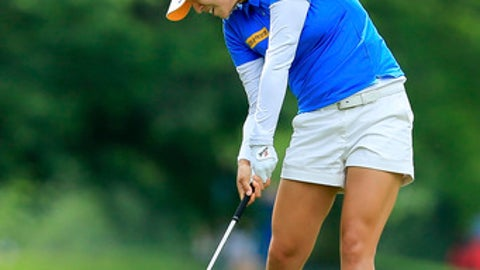 In Gee Chun hits her second shot on the 11th fairway during the second round of the LPGA Tour's Kingsmill Championship golf tournament in Williamsburg, Va., Friday, May 18, 2018. (John Sudbrink/The Daily Press via AP)